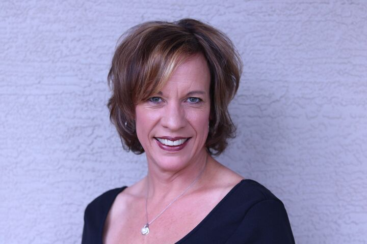Kimberly McLaughlin,  in Brooksville, Dennis Realty & Investment Corp.